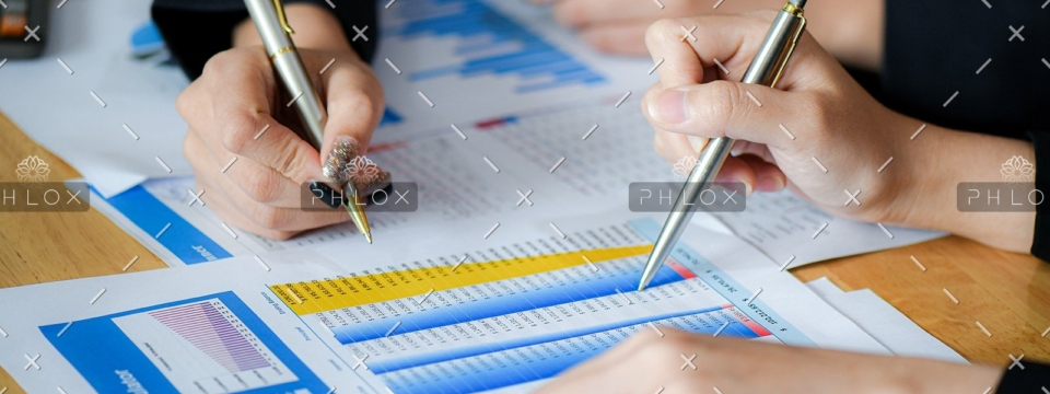 demo-attachment-489-female-office-staff-are-summarizing-the-number-in-6NXGYBK